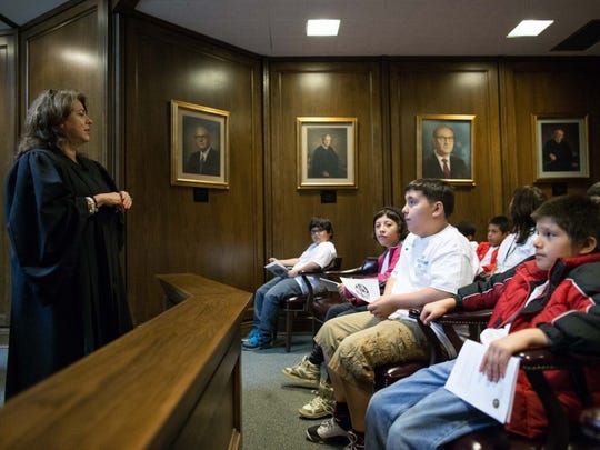 COURTNEY SACCO/CALLER-TIMES Justice Gina Benavides inside the 13th Court of Appeals courtroom explains to Evans Elementary School students how the court works during a tour given to them by the Corpus Christi Young Lawyers Association on Friday.