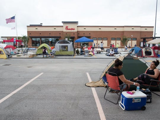 COURTNEY SACCO/CALLER-TIMES People wait outside of Corpus Christi's newest Chick-fil-A to be one of the first 100 people win free Chick-fil-A for a year.