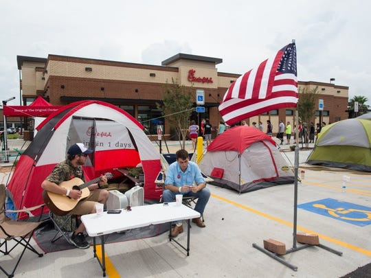 COURTNEY SACCO/CALLER-TIMES People wait outside of the newest Chick-fil-A on Wednesday to be one of the first 100 people to win free Chick-fil-A for a year when it opens. It will officially open on Thursday.