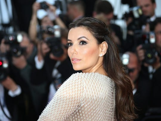 Associated Press photo Actress Eva Longoria arrives on the red carpet for the screening of the film Cafe Society and the Opening Ceremony at the 69th international film festival, Cannes, southern France, Wednesday, May 11, 2016.