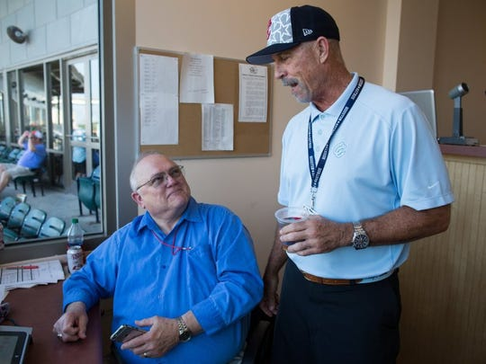 COURTNEY SACCO/CALLER-TIMES Hooks president Ken Schrom talks with pitch clock operator Edd Price in the press box before the Hooks' game against Springfield on Saturday. Schrom, along with former manager Keith Bodie, were the first inductees into the Texas League Hall of Fame with ties to the Hooks organization.