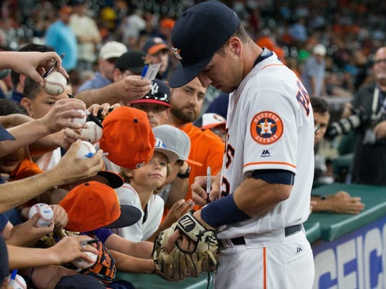 COURTNEY SACCO/CALLER-TIMES Alex Bregman sign autographs before his debut on Monday at Minute Maid Park. Alex Bregman t-shirts sold out during his debut.