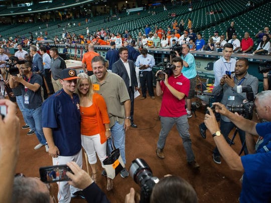 COURTNEY SACCO/CALLER-TIMES Alex Bregman stands with is parents Sam and Jackie as he is surrounded by members of the media during batting practice at Minute Maid Park on Sunday. About 50 of Bregman's friends and relatives attended his debut on Monday.