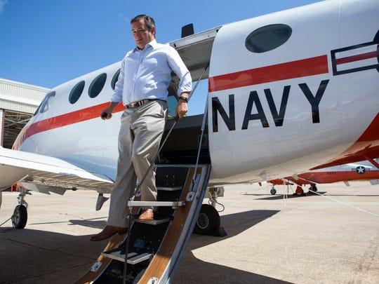 COURTNEY SACCO/CALLER-TIMES U.S. Sen. Ted Cruz, R-Texas, steps down from a training aircraft Thursday during a tour of Naval Air Station Corpus Christi.