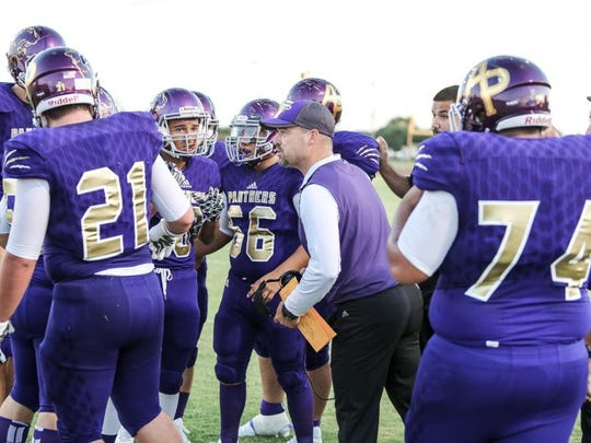 Micah DeBenedetto/Special to the Caller-Times Aransas Pass Head Coach Ryan Knostman talks with his team during a timeout against Rockport-Fulton at Bo Bonorden Memorial Stadium on Friday.