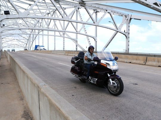 Rachel Denny Clow/Caller-Times A biker rides over the Harbor Bridge on Saturday, Aug. 27, 2016. The 7th annual Classic Rock 104.5/Edwards Law Firm Rock & Ride benefits active duty military through Operations for Warriors.