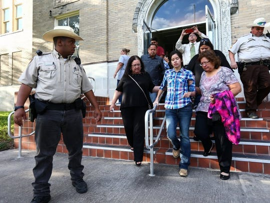 COURTNEY SACCO/CALLER-TIMES Mary Kristene Chapa (center) leaves the San Patricio County Courthouse in Sinton with her family after the jury returned a guilty verdict for David Malcom Strickland on Wednesday, Sept. 28, 2016. Strickland was convicted of the 2012 shooting that killed Mollie Judith Olgin and seriously injured Chapa at a Portland park.