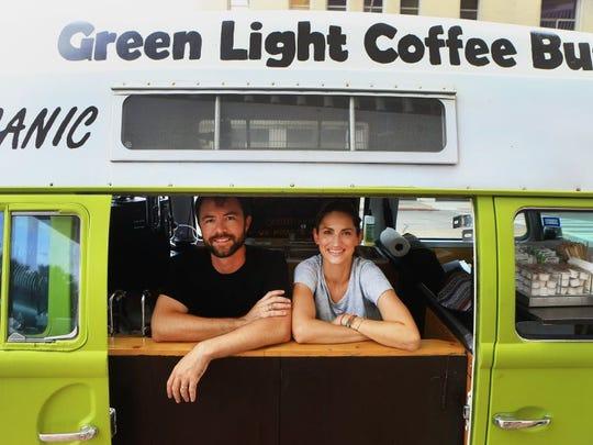 GABE HERNANDEZ/CALLER-TIMES file Owners Jordan Hans (left) and his wife, Sarah, pose July, 7, 2015, on the corner of Leopard and North Upper Broadway streets. The couple plan to open a drive-thru coffee stand on NAS Drive.