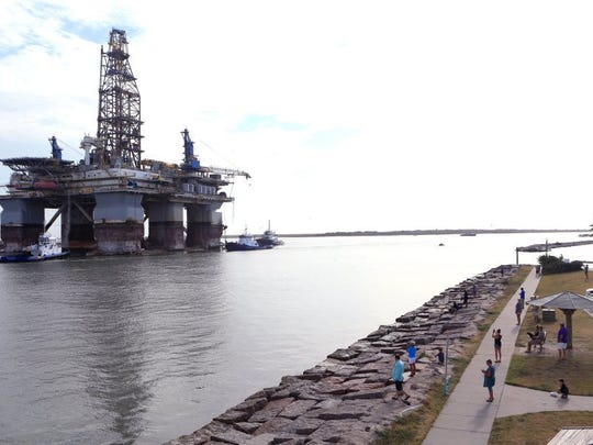 Rachel Denny Clow/Caller-Times A crowd gathers to watch as the Noble Jim Day, one of the world's largest offshore oil rigs, passes by Port Aransas on Thursday.