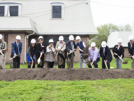 Caller-Times file Corpus Christi city officials and project stakeholders scoop dirt with shovels during the groundbreaking event for Lexington Manor, an affordable housing complex, last spring.