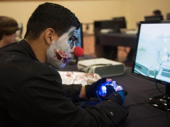 Charlie Blalock/ Special to the Caller-Times Emilio Esparza, dressed as a killer clown, plays Black Ops II at Realms Con on Saturday, Oct. 1, 2016, at American Bank Center.