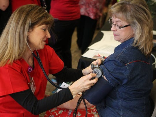 Michelle Gaitan/Standard-Times A registered nurse from Shannon Medical Clinic administers a blood pressure test at an event in San Angelo. Health care professionals are in acute demand among the region's employers. shot/archived 0204
