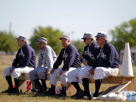 Men dressed in baseball uniforms treated patrons to an 1800s-style baseball game at the 2015 Fort Concho Frontier Day.