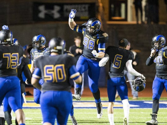 Andrew Mitchell/Standard-Times Angelo State University's Clayton Callicutt celebrates with teammates after ASU recovered a fumble on defense during the Lonestar conference semi-final playoff game against Midwestern State University Saturday evening. Shot 11.08.2014
