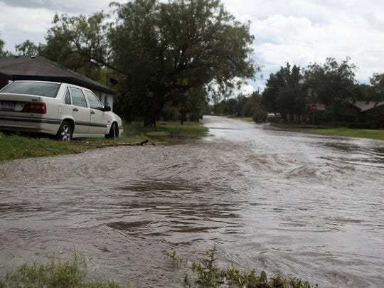 Rainfall often leaves flood-prone Avenue P awash after significant storms.
