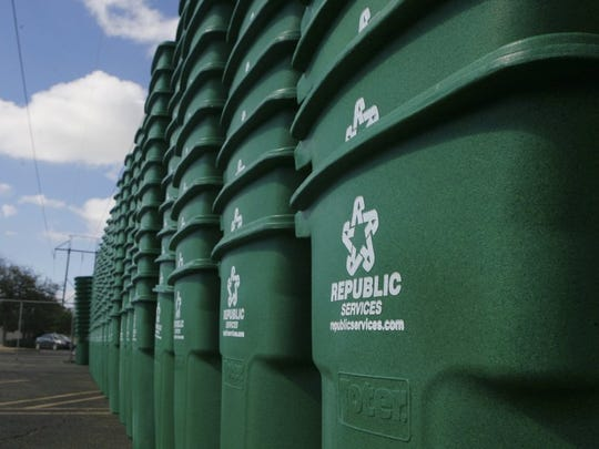 Standard-Times file Stacks of 96-gallon recycling bins tower in a parking lot on Sunset Drive. The bins, now at households across San Angelo, sometimes are contaminated with trash, but Republic Services sends the contents of all recycling bins to Butts Recycling to sort through.