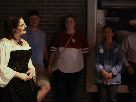 Caity Roberts tells ghost stories during Be Theatre's Ghost Walk Saturday, Oct. 14, in downtown San Angelo.