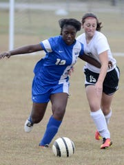 Fayette-Ware's Whitney Bonds and South Side's Mallory McKinney battle for posession of the ball.