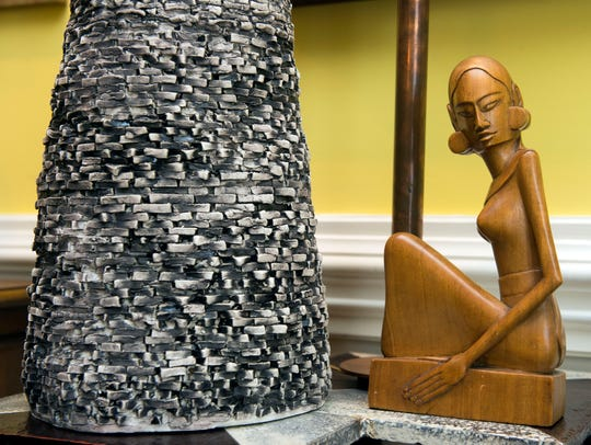 The small wooden sculpture is the first piece of art