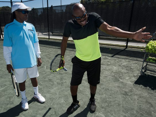 Local tennis pro Linsley McMillion, right, gives pointers
