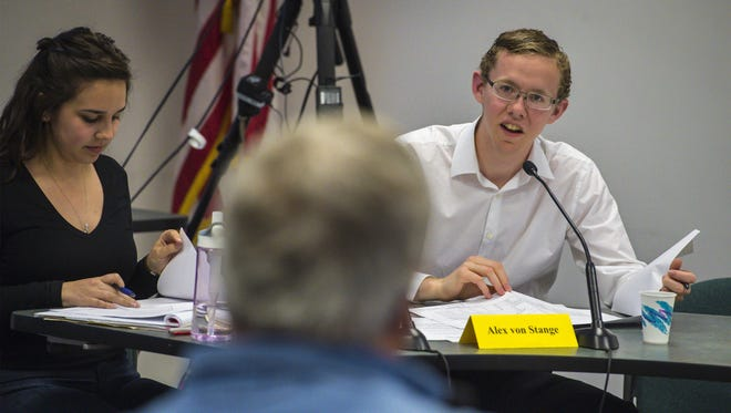 Alex von Stange, right, a CVU student and member of Shelburne's Development Review Board, questions Bill Posey as Posey speaks to the board earlier this month. Board Coordinator Kaitlin Mitchell at left.GLENN RUSSELL/FREE PRESS