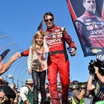 Jeff Gordon and his daughter Ella greet the fans during