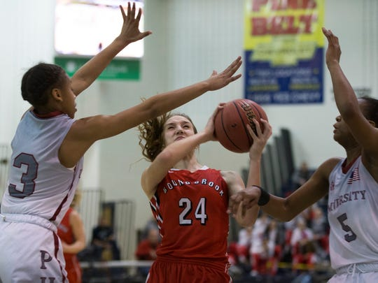 Bound Brook's Cortlyn Morris went down hard after a collision on this play and had to leave the game. Bound Brook vs University in Public Group 1 Girls Basketball Final in Toms River NJ, on March 12, 2017.