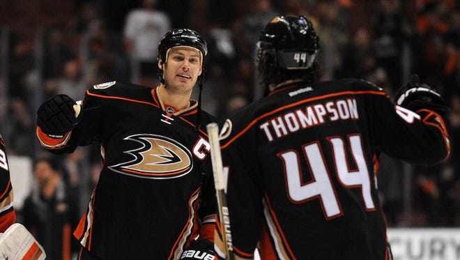 Anaheim Ducks center Ryan Getzlaf (15) celebrates with center Nate Thompson (44) the 4-3 shootout victor against St. Louis Blues at Honda Center.