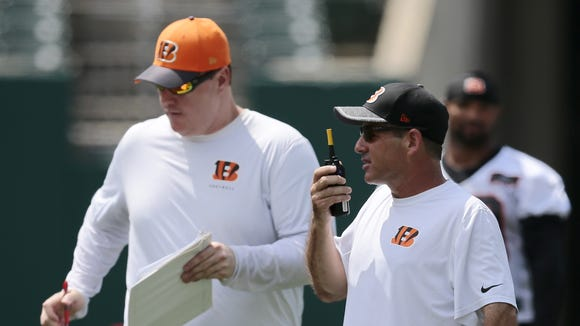Bengals offensive coordinator Ken Zampese (right) called his first official NFL game on Sept. 11 in a Bengals victory over the New York Jets.