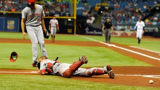 Cincinnati Reds catcher Devin Mesoraco (39) in unable to field a foul ball as Cincinnati Reds starting pitcher Tim Adleman (46) looks on during the first inning against the Tampa Bay Rays.