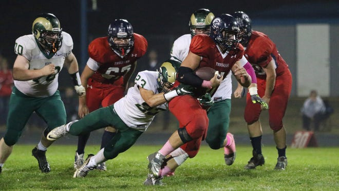 Regis's Eric Gustin tries to take down Kennedy's Jacob Lopez in a Tri-River Conference game Thursday, Oct. 8, 2015, in Mount Angel. Kennedy defeated Regis 14-6.