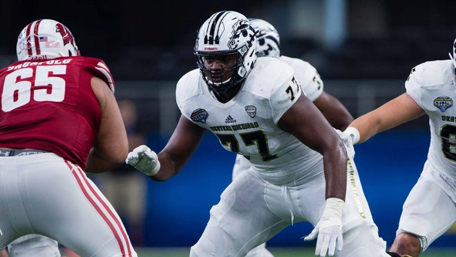 Western Michigan Broncos offensive lineman Chukwuma Okorafor (77)  in action during the game against the Wisconsin Badgers in the 2017 Cotton Bowl game at AT&T Stadium. The Badgers defeated the Broncos 24-16.