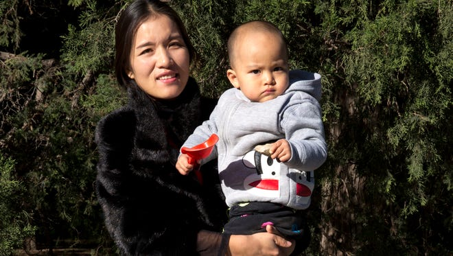 Chen Xiaoling poses with her son Xu Zhisheng at a park in Beijing, China, Friday, Oct. 30, 2015. Chen, from Hebei province outside Beijing, wasn't eligible for more than one child, but had a second, anyway. She had to pay a 40,000-yuan ($6,325) fine.