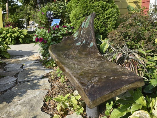 """John Soukup's untitled, free-form bench spent the summer in front of Bliss as part of the """"Benches By the Bay"""" community art project in Sturgeon Bay. This and 24 other benches go up for auction Sept. 16 as part of the city's Harvest Festival that day."""