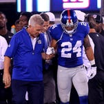Bennett Jackson of the Giants is assisted off the field after an injury in the second half against the Jacksonville Jaguars at MetLife Stadium on August 22.