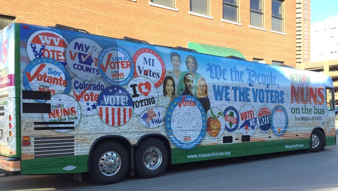 The Nuns on the Bus tour returned to Des Moines on Friday. The bus is shown parked in front of the Polk County Election office at 120 2nd Ave. in downtown   Des Moines.