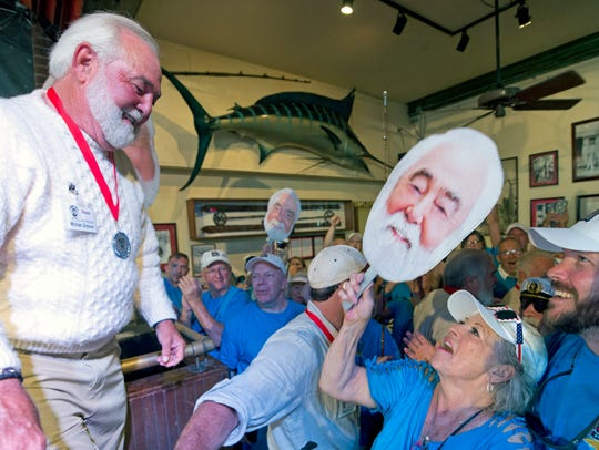 Michael Groover, left, husband of celebrity chef Paula Deen, right, walks off the stage after competing in the semi-final round of the Hemingway Look-Alike Contest at Sloppy Joe's Bar in Key West, Fla. (Andy Newman/Florida Keys News Bureau via AP)