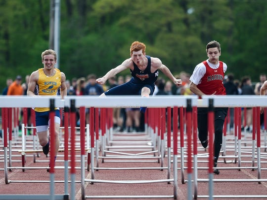 Gallon's Colin McCullough bounds over the hurdles during