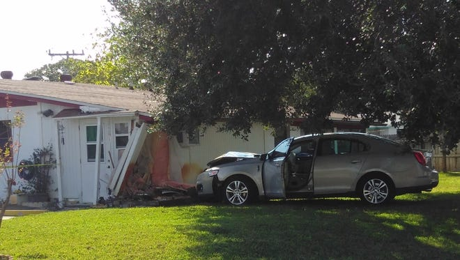 Police are looking for the gunman who fired at a car that crashed into a house in Titusville. They're also looking for the driver.
