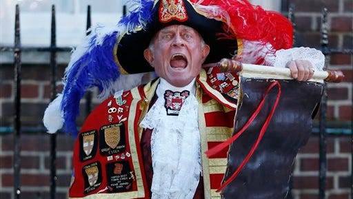 In this file photo,Tony Appleton, a town crier, announces the birth of the royal baby, outside St. Mary's Hospital exclusive Lindo Wing in London, Palace officials say Prince William's wife Kate has given birth to a baby boy. Riffing off prior Monegasque ritual, Prince Albert II set the ground rules for how Monaco announced the births of little Gabriela and Jacques to Princess Charlene on Wednesday.