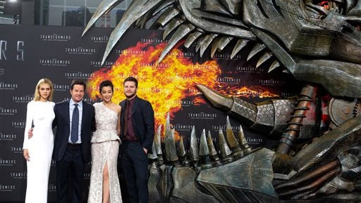 """In this file photo, from left, actors Nicola Peltz, Mark Wahlberg, Li Bingbing, and Jack Reynor pose for photographers, during the European premiere of the film """"Transformers: Age of Extinction,"""" at Potsdamer Platz in Berlin. Transformers"""" is rolling out with the most nominations at this year's Golden Raspberry Awards. The action sequel starring Wahlberg alongside the morphing robots led the Razzie lineup Tuesday with seven nominations, including worst picture, worst sequel, worst screenplay and worst screen combo."""