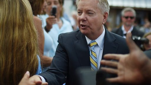 Sen. Lindsey Graham, R-S.C. greets supporters after announcing his bid for presidential election on Monday, June 1, 2015, in Central, S.C.