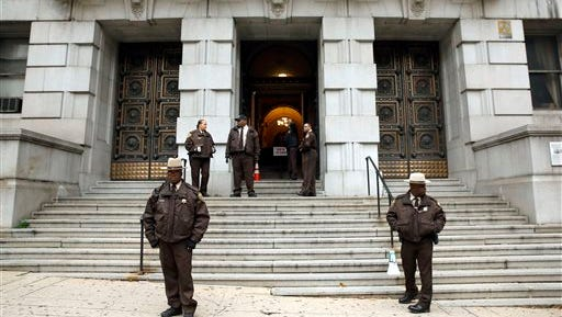 Members of the Baltimore City Sheriff's Office stand outside Clarence M. Mitchell Jr. Courthouse, Monday, Nov. 30, 2015, in Baltimore, after the arrival of William Porter, one of six Baltimore city police officers charged in connection to the death of Freddie Gray.