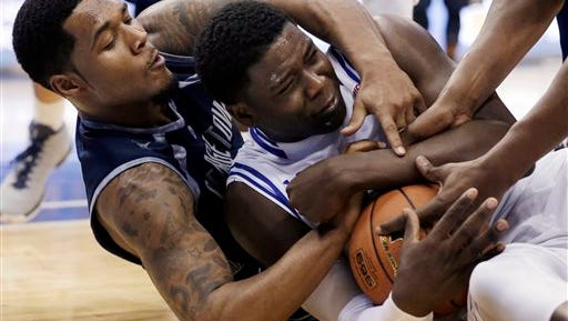 Seton Hall forward Angel Delgado, right, holds on to the ball as Georgetown guard D'Vauntes Smith-Rivera, left, tries to make a steal.