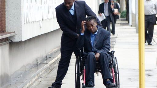 """Dontrell Stephens arrives at the U.S. Federal Courthouse in downtown Fort Lauderdale, Fla., Monday, Feb. 1, 2016. Palm Beach County Sgt. Adams Lin testified under cross-examination that """"the totality of circumstances"""" led him to believe Stephens had drawn a gun on Sept. 13, 2013, and was about to shoot him when he pulled his service weapon and shot Stephens four times, leaving him paralyzed."""