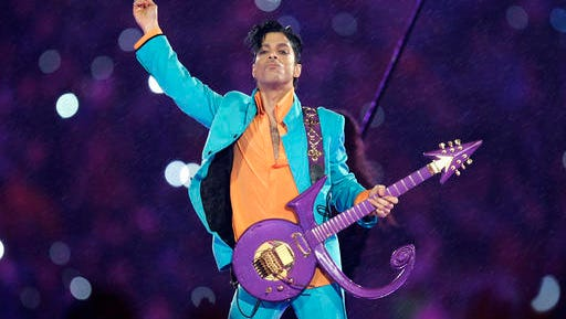In this Feb. 4, 2007, file photo, Prince performs during the halftime show at the Super Bowl XLI NFL football game at Dolphin Stadium in Miami. Prince died at his home in Chanhassen, Minn. on April 21, 2016 at the age of 57.