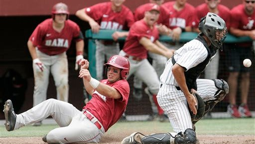 Alabama's Georgie Salem slides into home to score as Kennesaw State's cather Max Pentecost fields the throw in the fifth inning of an NCAA regional college baseball game on Monday,  June 2, 2014, in Tallahassee, Fla. Kennesaw State beat Alabama 4-2.  (AP Photo/Steve Cannon)