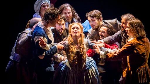 """Lucy Briggs-Owen as Viola with members of the """"Shakespeare in Love"""" theater company."""