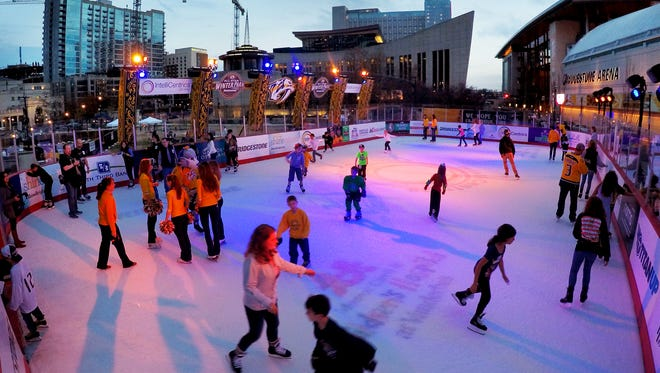 People ice skate at Bridgestone Winter Park,  which opened Saturday Dec. 12, 2015. The outdoor ice skating rink was created as a focal point for NHL All-Star festivities.