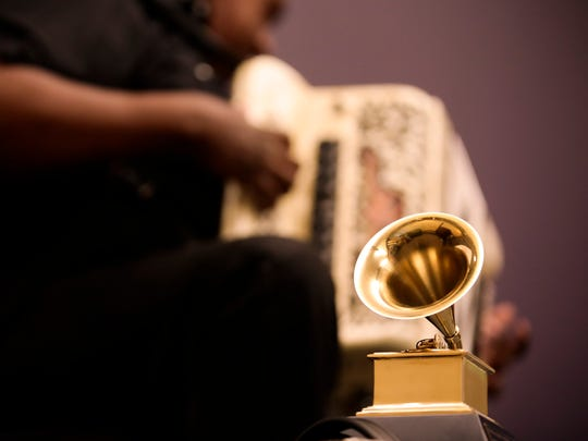 Chubby Carrier performs behind his Grammy award during an Acadiana Roots session at the Daily Advertiser in Lafayette March 24, 2016.
